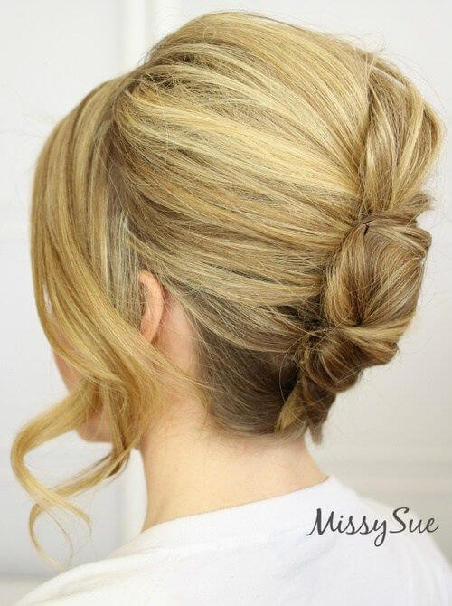Leave a little hair out of the updo for an updated French twist.