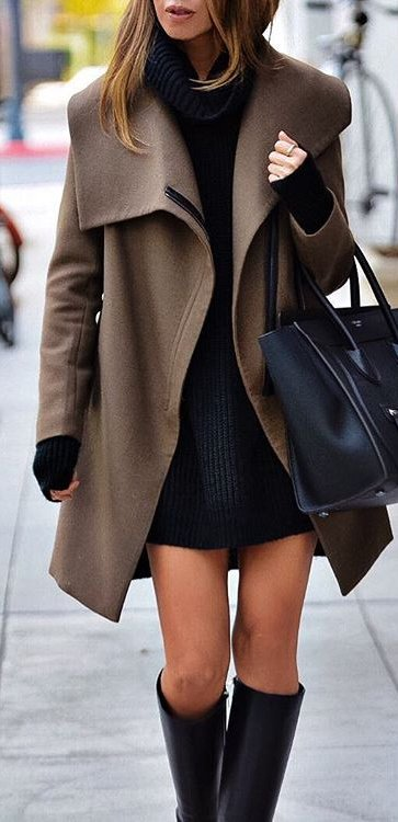 Stylish woman in a black woolen oversized sweater and brown coat