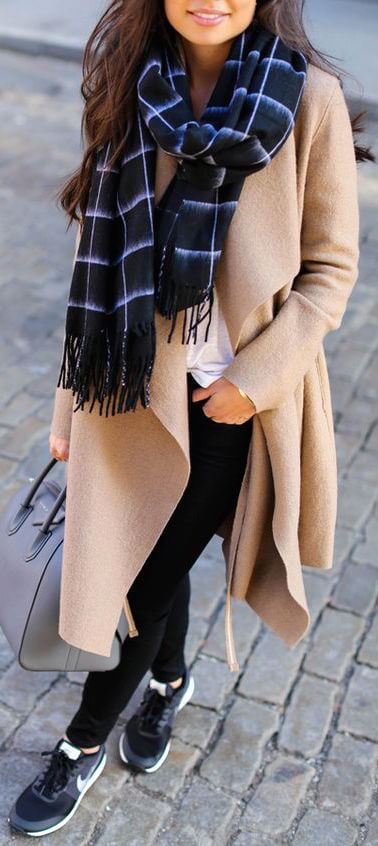 A long wrap coat in neutral beige fits perfectly with sporty Nike trainers.