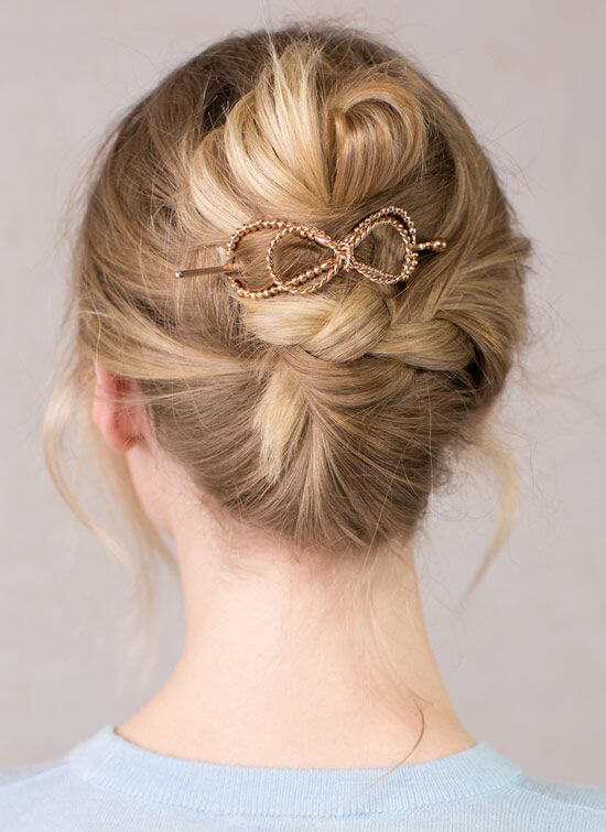 Combine a braided updo and a French twist to get this pretty updo that's easy to pull off.