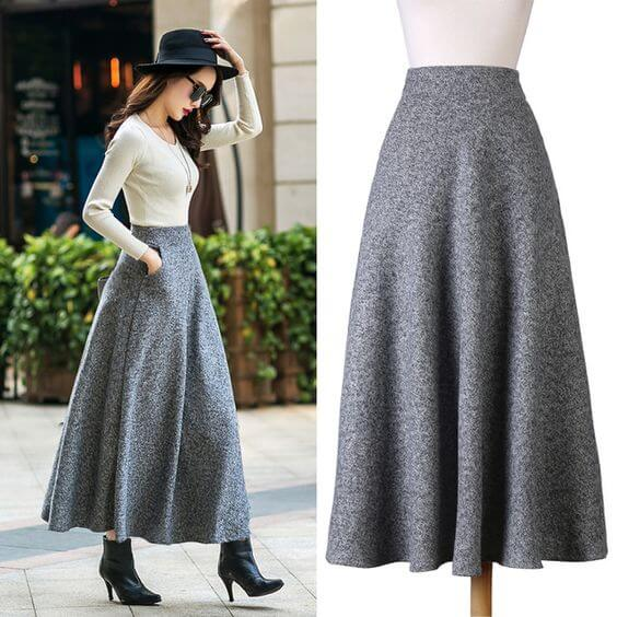 Woman in a gray woolen maxi skirt