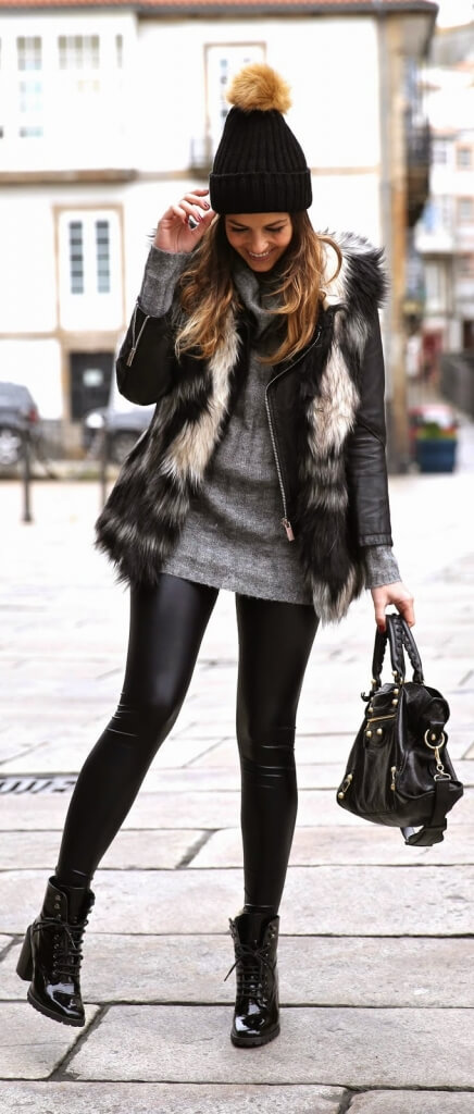 What a cute look: woman in black leather leggings, gray woolen sweater, and faux fur waistcoat