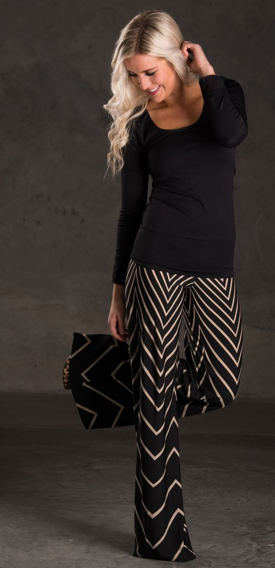 Woman in palazzo pants with golden chevron prints
