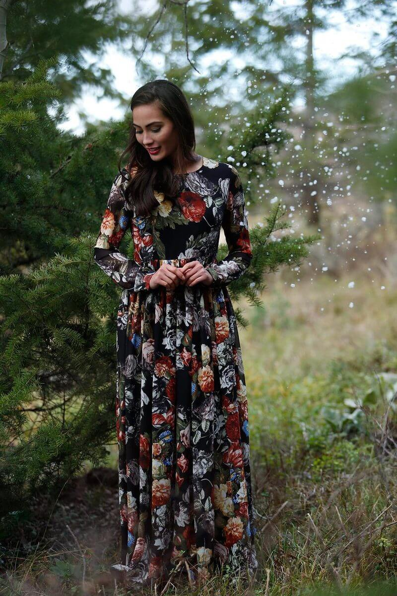A woman in the park wearing an elegant floral maxi dress