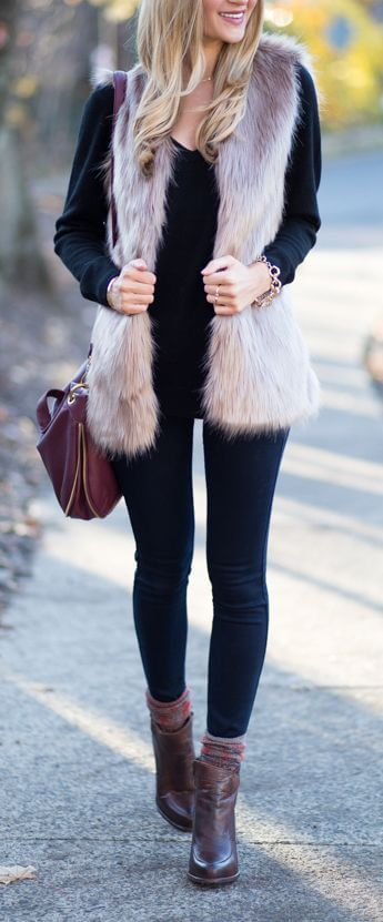 Woman in V-neck top and long sleeveless faux fur pullover vest