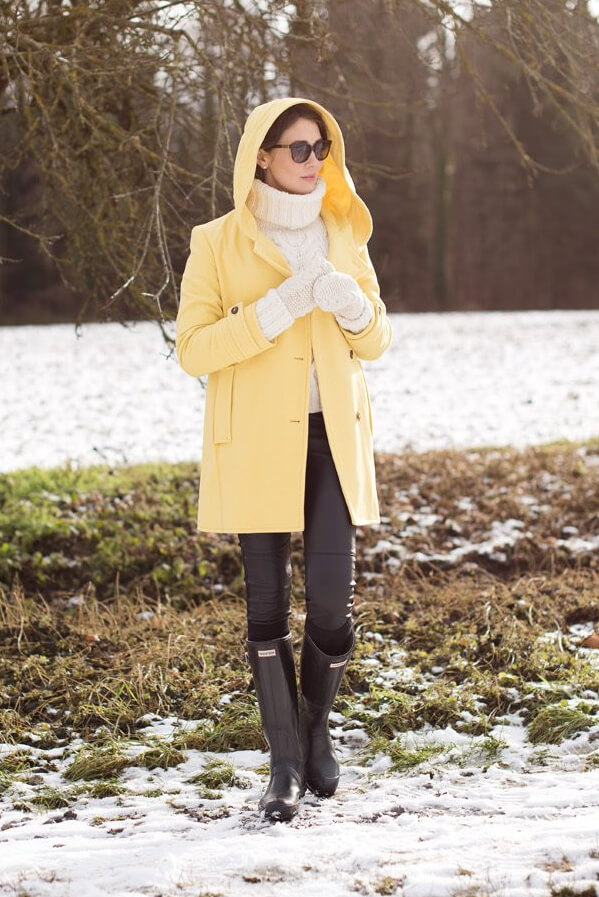Woman in yellow coat and wellies