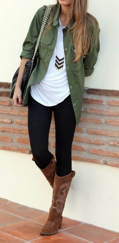 Woman wearing black leggings, white T-shirt, olive green shirt and brown boots