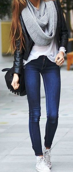 Wearing Converse sneakers for edgy winter style.