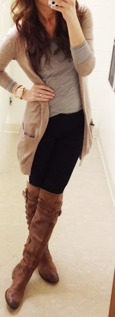 Woman wearing a gray top, long beige cardigan, black leggings and over-the-knee brown leather boots
