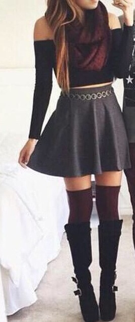 What a seductive look: young woman wearing high waisted skirt and socks with boots