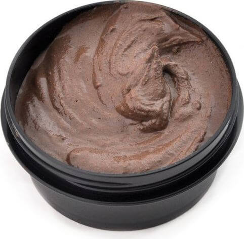 Black tub of chocolate face mask mixture