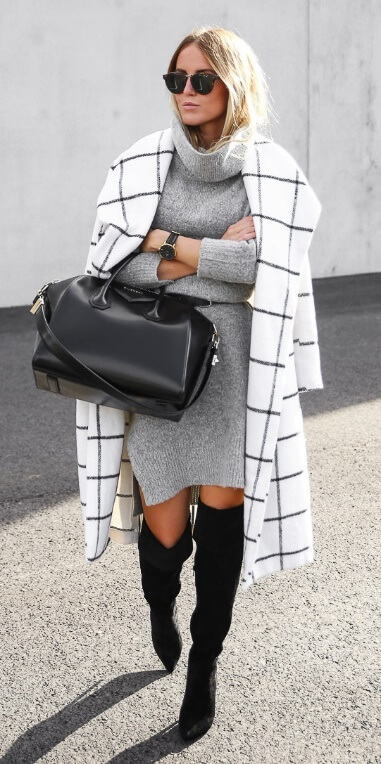 Stylish blonde in grey turtleneck woolen dress and black thigh-high boots