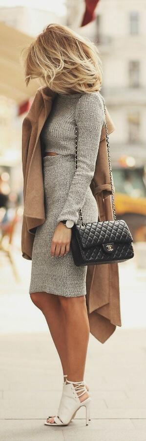 Blonde woman in grey woolen pencil skirt and matching woolen crop top