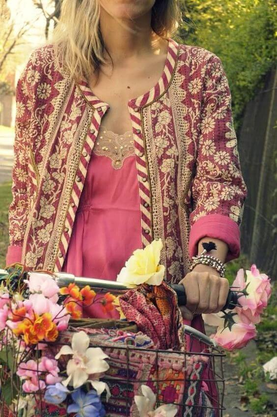 Blonde woman in pink dress and embroidered patchwork jacket