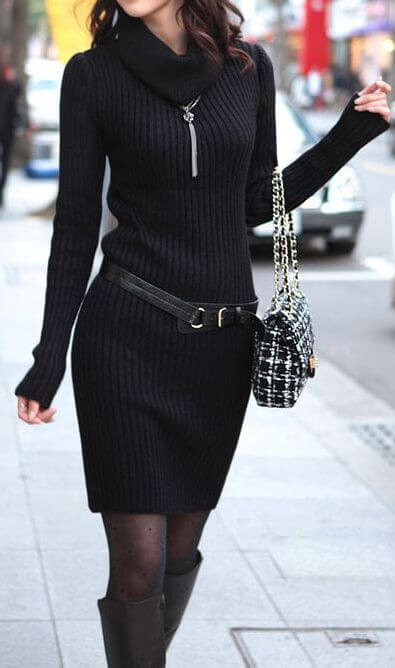 Stylish brunette in black turtleneck woolen sweater dress and black boots