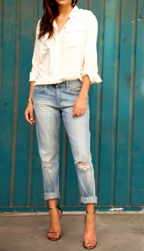 Brunette in blue boyfriend jeans and white blouse