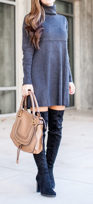 Stylish brunette in grey woolen turtleneck dress and black suede boots