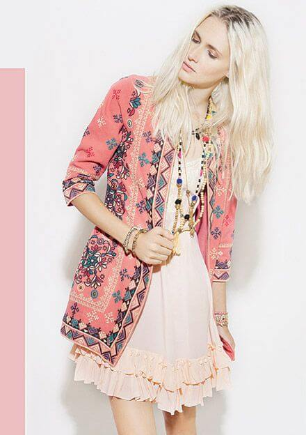 Chic blonde in blush pink dress and pink patchwork jacket