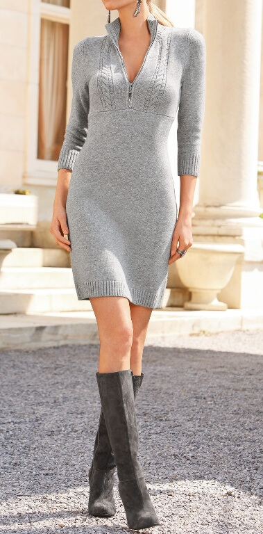 Chic blonde in grey woolen dress and knee-high suede boots