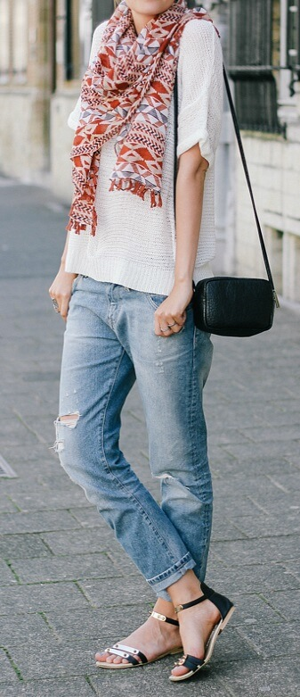 Chic woman in boyfriend jeans and patterned scarf
