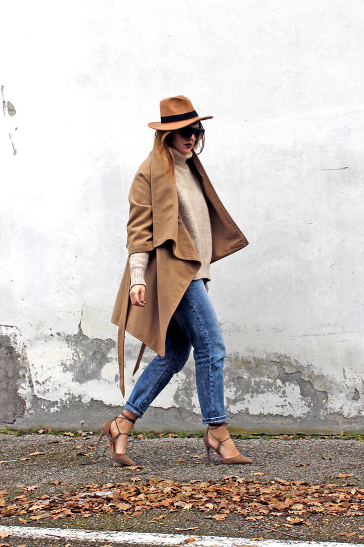Elegant woman in coat and jeans