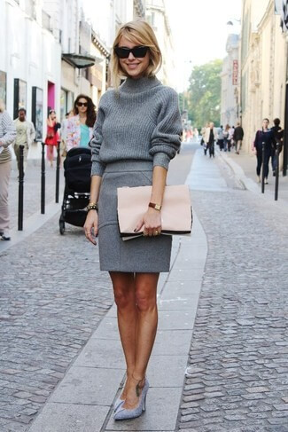 Pretty blonde in grey woolen skirt and grey turtleneck sweater