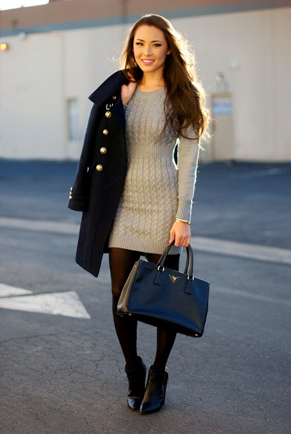 Pretty brunette in grey sweater dress and navy blue military coat