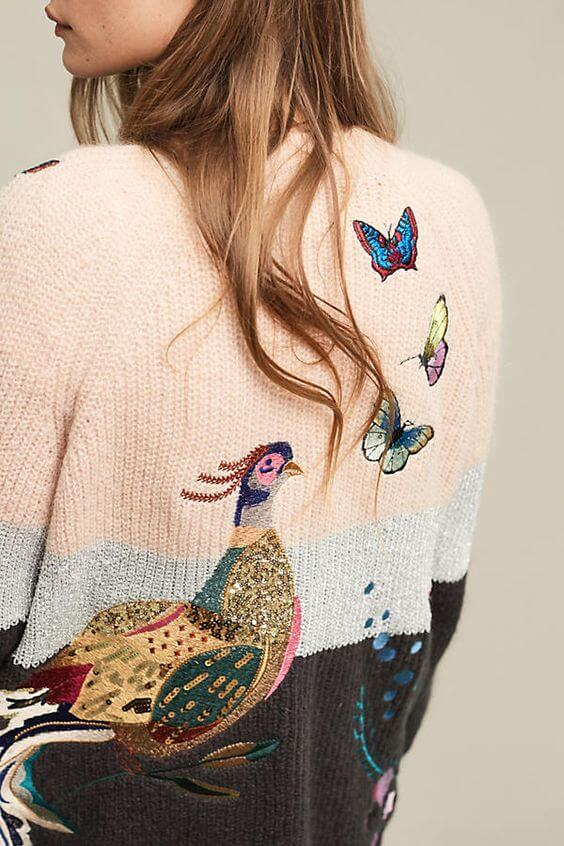 Pretty brunette in peacock patchwork cardigan