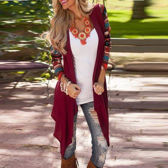 Stylish blonde in ripped jeans and burgundy patchwork cardigan