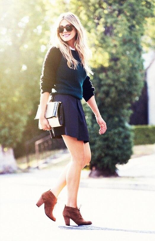 Stylish blonde in woolen skirt and dark brown suede brogue boots