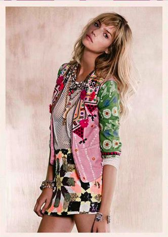 Stylish blonde woman in colorful patchwork jacket