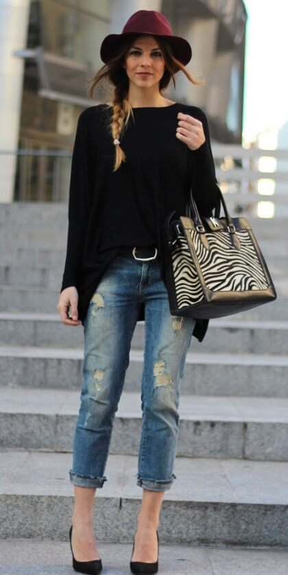 A draped black top adds volume and shape to boyfriend jeans.