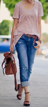 Stylish woman in pink cotton top and boyfriend jeans