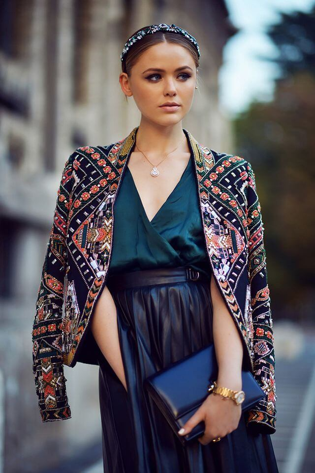 Stylish woman in silk top and patchwork jacket