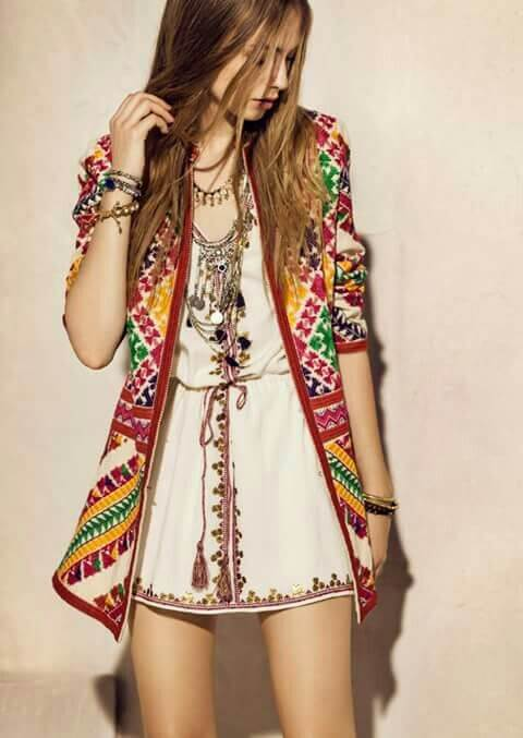 Trendy blonde in cream embroidered dress and patchwork cardigan