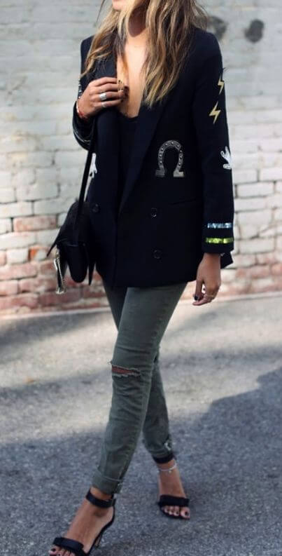 Trendy blonde in ripped skinny jeans and patchwork blazer