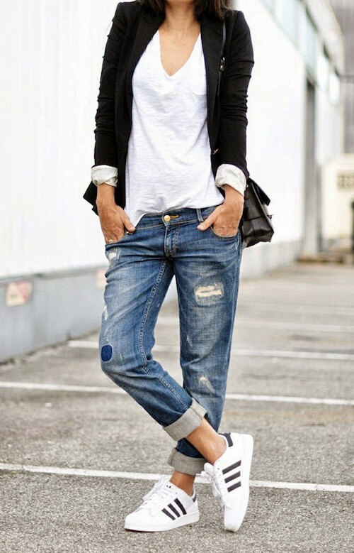 Trendy brunette in Adidas Superstar sneakers and boyfriend jeans