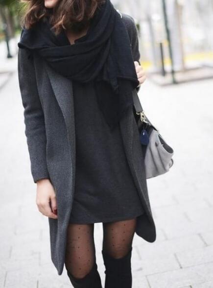 Trendy brunette in dark grey woolen dress and long grey coat