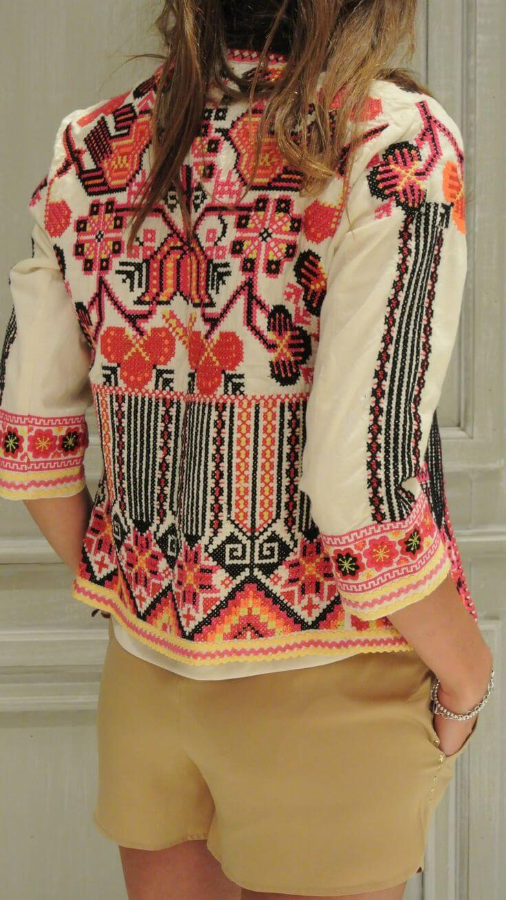 Trendy woman in camel shorts and patchwork cardigan