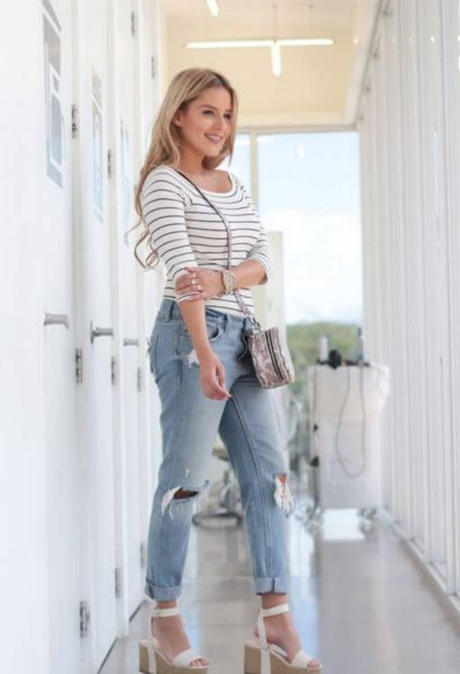 Woman in bright outfit with jeans