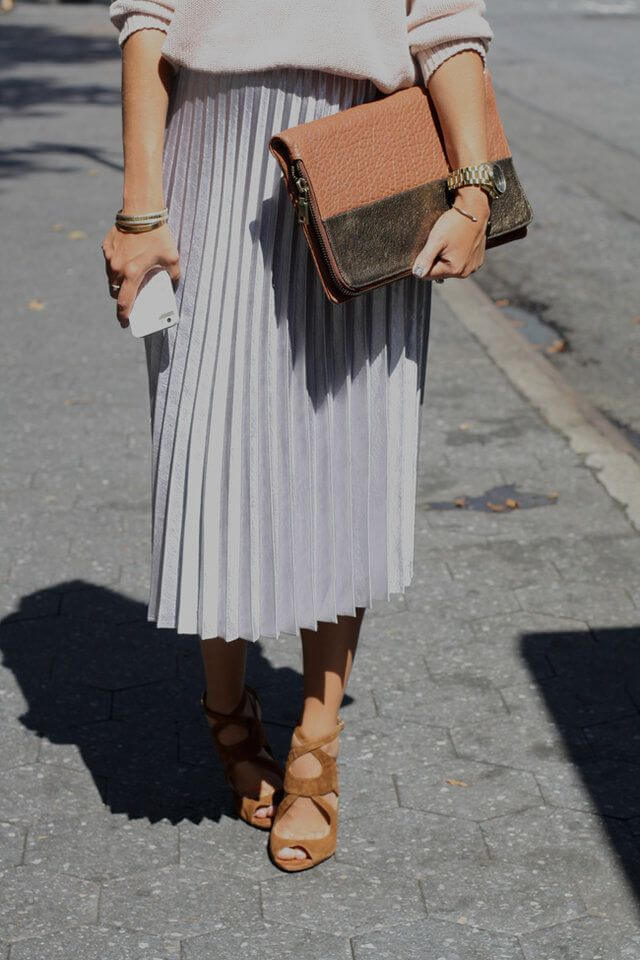 Chic woman in midi pleated woolen skirt and blush woolen sweater
