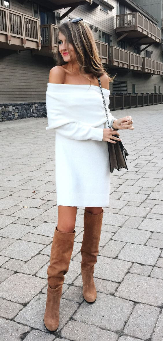 Stylish woman in white off-the-shoulder woolen dress and brown suede boots