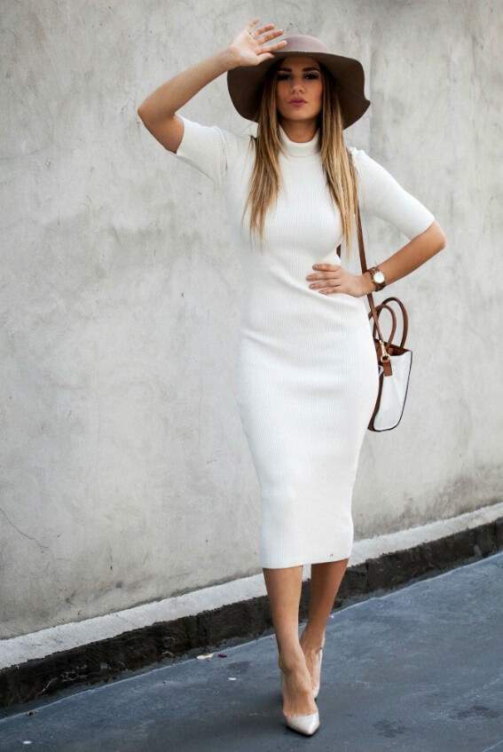 Glamorous woman in white turtleneck midi woolen dress and brown hat