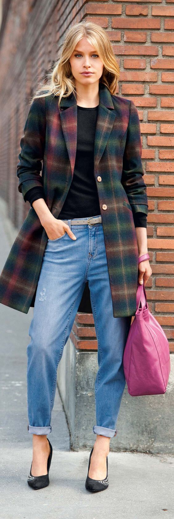 Woman wearing a tartan coat, a top and jeans