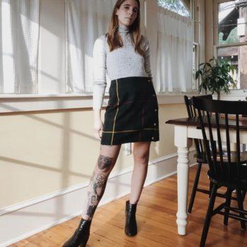 Woman wearing a cute black wool skirt