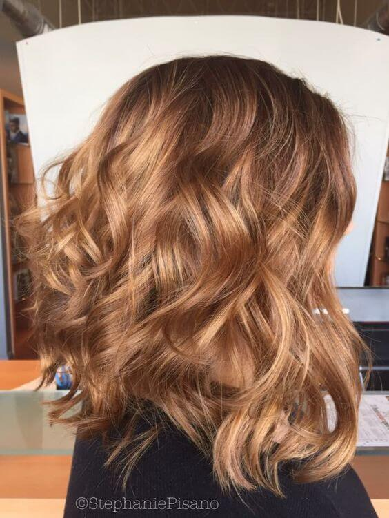 You'll love the way your hair shines with a caramel blonde do like this wavy lob