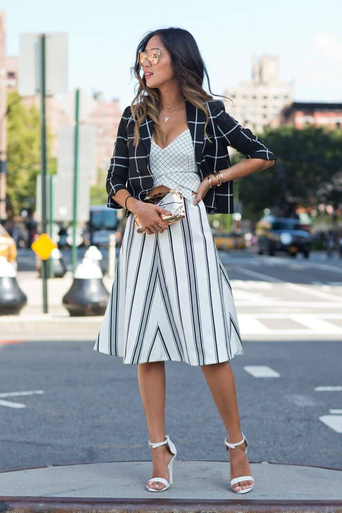 Mixing checked print blazer and lines skirt but keeping the look simple in black and white colors