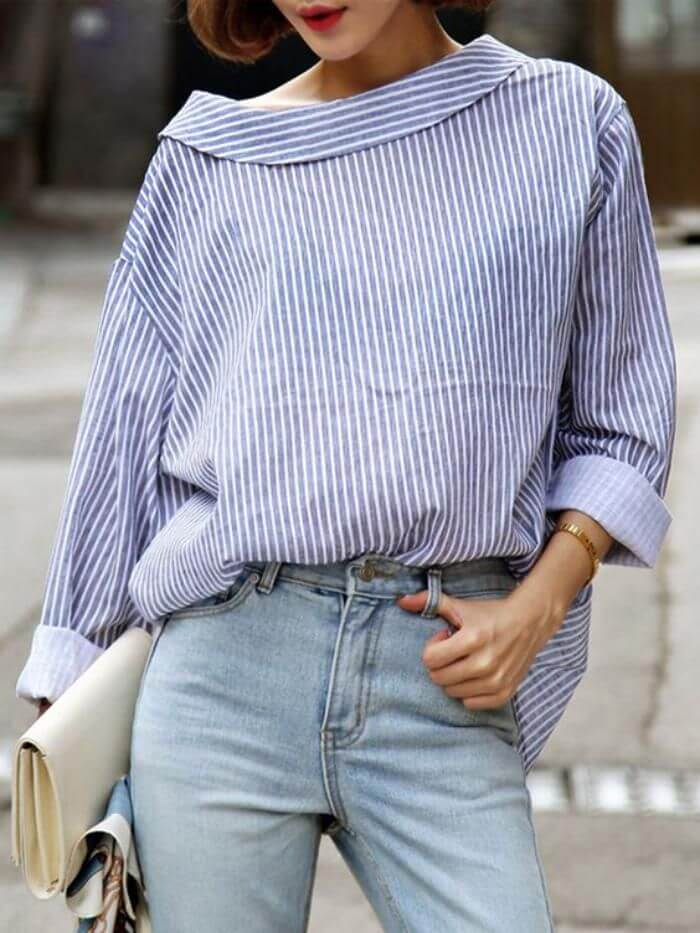 Chic brunette in stonewashed jeans and boat-neck striped shirt. Channel old Hollywood glamor in boat-neck stripes and bold red lipstick.