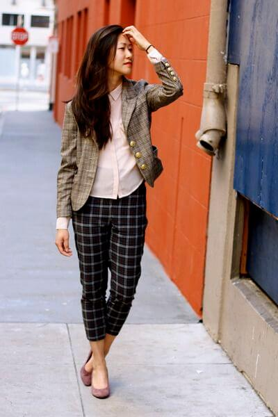 Chic lady with plaid blazer and pants in a different color. Trendsetter, not a follower!