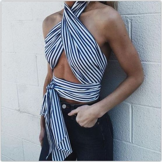 Chic woman in wrapped striped scarf and blue jeans. As the heat rises, a striped scarf can do wonders to keep you cool!